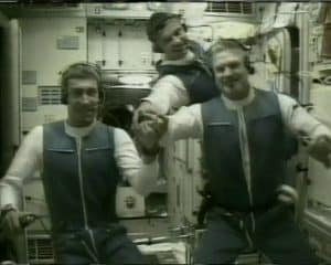 Expedition 1 crew of Sergei K. Krikalev, left, Yuri P. Gidzenko, and William M. Shepherd talking to the Flight Control Center in Korolev, Russia, outside of Moscow, from the International Space Station's Zvezda Service Module