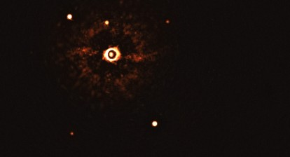 First Ever Image of Exoplanets around a sunlike star. Credit: ESO/Bohn et al.