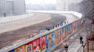 This image of the Berlin Wall was taken in 1986 by Thierry Noir at Bethaniendamm in Berlin-Kreuzberg.