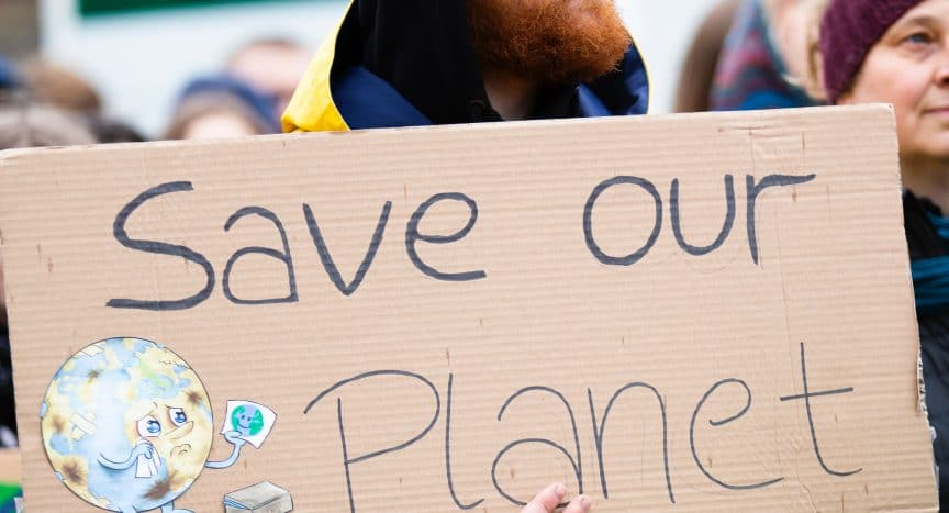 """Protestor holding up a """"save our planet"""" sign. Photo by Markus Spiske from Pexels - 360onhistory.com"""
